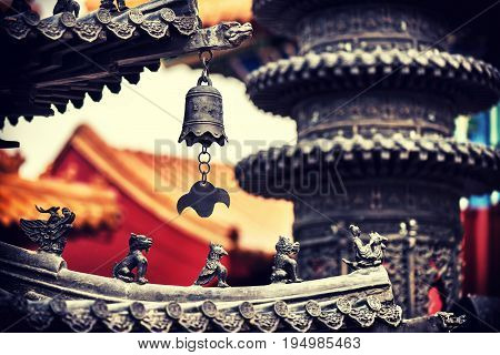 Red pagoda roof and Asian architectural details in oriental garden at summertime