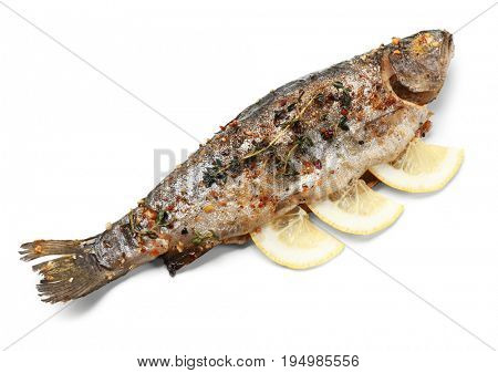Delicious freshly fried fish with lemon slices on white background