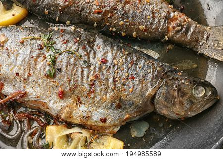 Frying pan with tasty trout fish, closeup