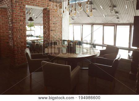 Modern interior of beefsteak house in underground style