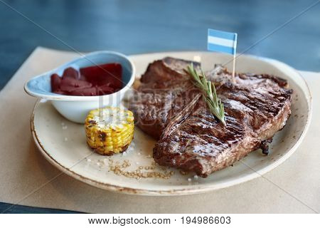 Composition with tasty beefsteak and vegetables on plate