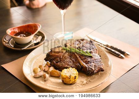 Grilled beefsteak with vegetables and herbs on plate