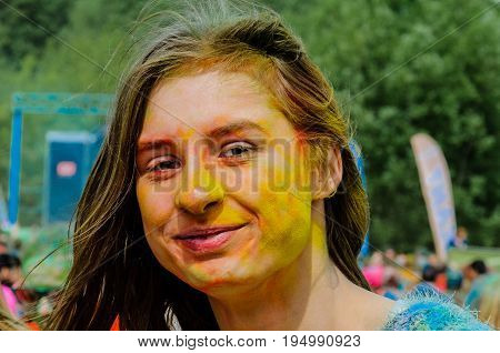 Moscow, Russia - June 3, 2017: Multicolored portrait of young pretty girl at a colorful festival. Traditional Indian festival Holi turned into a fun event in many countries of the world
