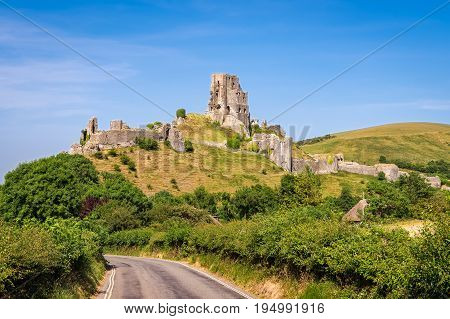 Wareham United Kingdom - June 20 2017: Ruins of Corfe Castle built in medieval times by William the Conqueror in the Isle of Purbeck in Dorset viewed from the village below.