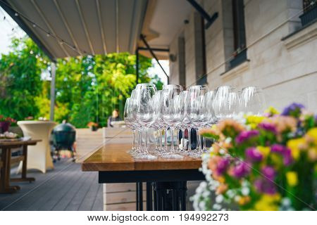 Preparing A Terrace For The Event. On The Summer Terrace There Are Tables With Glasses. The Concept