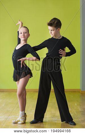Dance children couple dancing ballroom dance in class.