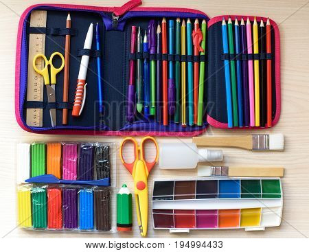 Back To School Concept On Table Wooden Background. Selection Of Shool Accessories.