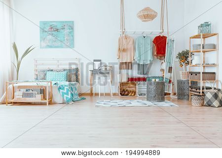 Spacious cozy bright room with small rug and creative wardrobe