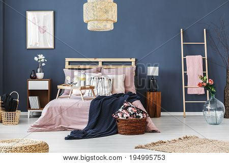 Cozy fully furnished bedroom with floral motif decorations