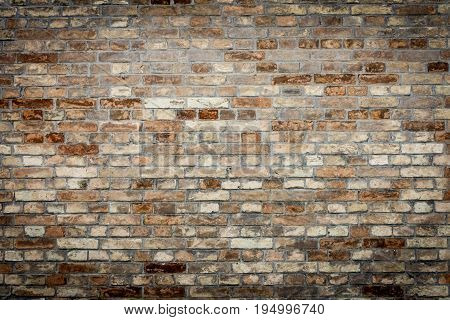 Background of old vintage brick wall texture with nice vignetting