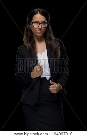 Beautiful Confident Businesswoman Posing In Black Suit, Isolated On Black