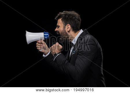 Handsome Bearded Angry Businessman Yelling In Megaphone, Isolated On Black