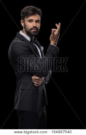 Handsome Bearded Businessman Posing In Black Suit, Isolated On Black
