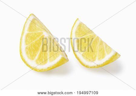 two similar juicy lemon segments isolated on white
