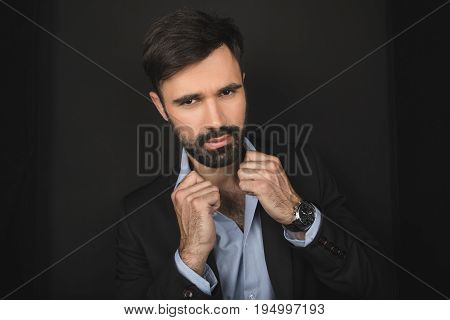 Handsome Bearded Confident Businessman Posing In Black Suit, Isolated On Black