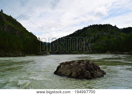 Rock on Katun river in Altay mountains. Chemal Altay Republic Siberia Russia.