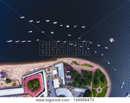 Aerial photo of bay with floating sailing yacht fleet in marina, concept of yachting, regatta