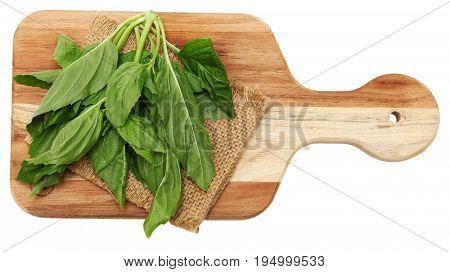 Yu Choy Leaf bundle on cutting board.