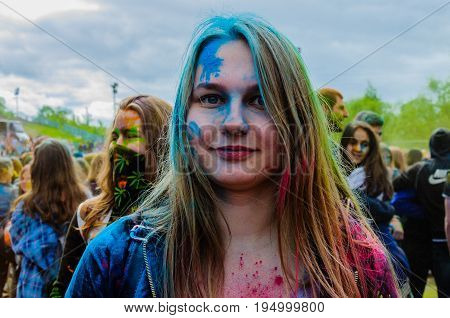 Moscow, Russia - June 3, 2017: Portrait of a teenage girl in traditional paints of holi at a summer festival. Summer Indian Holi turned into a fun event in many countries of the world
