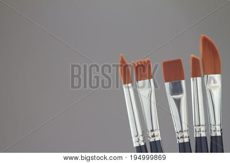Artistic brushes in the workshop. Brushes artist on neutral grey background and add copy space for text.