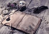 Retro styled still life with old diary, black candle and mystic objects. Vintage romantic concept. Mystic and occult still life poster