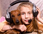 The child and dog listen to music in headphones poster