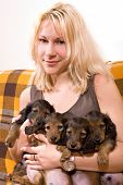 blonde girl holds long-haired puppy dogs dachshund poster