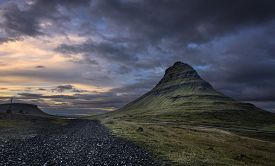 Kirkjufell mountain at Dusk with a rock pathway on the left