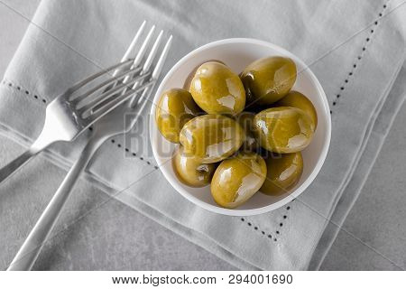 Bowl With Canned Fresh Olives On Concrete Background