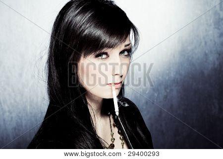 black hair woman in leather jacket, smoking, studio shot