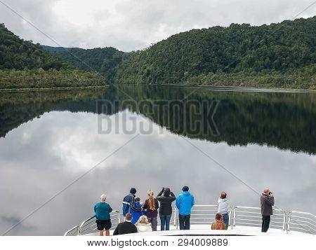 Tourists Enjoying A Gordon River Cruise In Tasmania, Australia