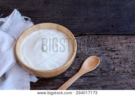 Natural Homemade Plain Organic Yogurt In Wood Bowl On Wood Texture Background, Copy Space