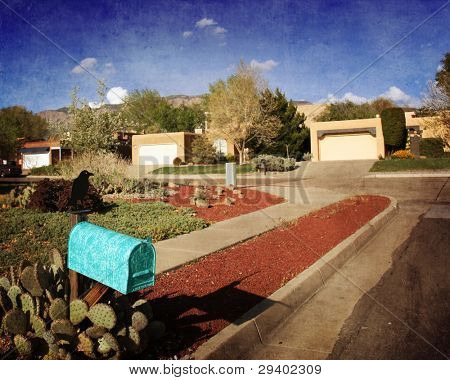 Typical neighborhood in Albuquerque, New Mexico with a quaint turquoise mailbox