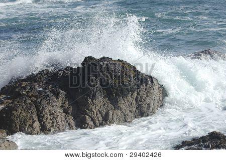 sea surf breaking over rocks in waves poster