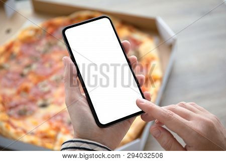 Female Hands Holding Phone With Isolated Screen Above The Pizza Box