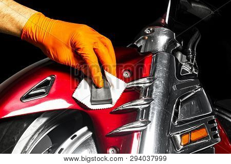 Car Polish Wax Worker Hands Applying Protective Tape Before Polishing. Buffing And Polishing Motorcy