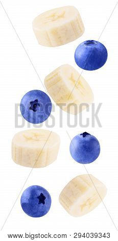 Falling Fresh Berries And Banana Isolated On White Background