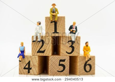 Miniature People: Business People Sitting On Wooden Box With Number 1,2,3,4,5 And 6. Business Career