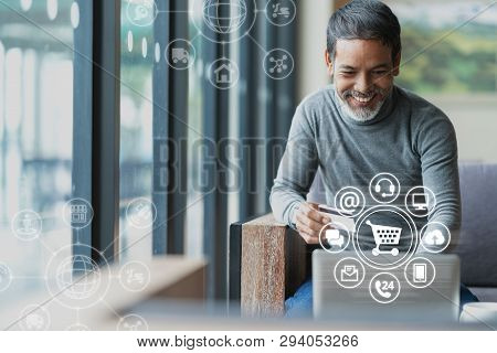 Asian Or Hispanic Man Using Laptop And Credit Card Payment Shopping Online With Icon Customer Networ