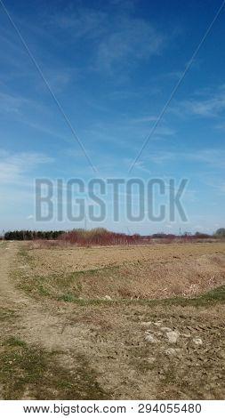 Idyllic Field Soil Outside In Nature. Peaceful Landscape.