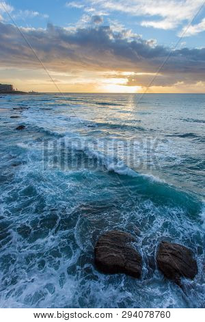 Sunrise At Newcastle Beach - New South Wales Australia. Located On The Coast A Few Hours North Of Sy