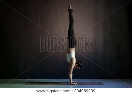 Woman Practicing Yoga, Adho Mukha Vrksasana Exercise, Downward Facing Tree Pose