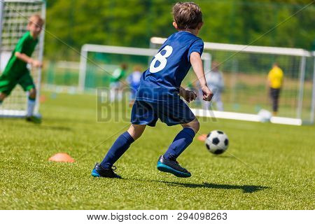 Football Soccer Players Running With Ball. Footballers Kicking Football Match. Young Soccer Players