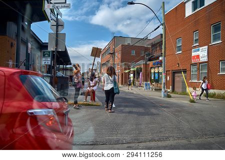 Montreal, Quebec, Canada September 29, 2018: People Stand At Avenue Henri-julien, Montreal, Canada.