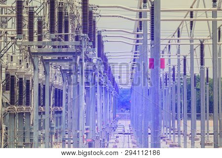 Electric power transmission lines, High voltage power transformer substation, High voltage switchgear and equipment in front of power plant. The concept of source energy poster