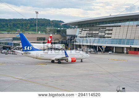 ZURICH, SWITZERLAND - CIRCA OCTOBER, 2018: Scandinavian Airlines System (SAS) aircraft taxing at Zurich International Airport.