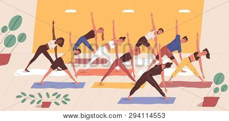 Cute Funny People Practicing Yoga Together. Group Of Smiling Active Men And Women Performing Gymnast
