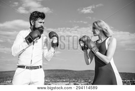 Relations As Struggle Concept. Man And Woman Fight Boxing Gloves Blue Sky Background. Couple In Love