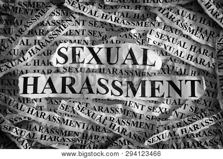 Sexual Harassment. Torn Pieces Of Paper With The Words Sexual Harassment. Concept Image. Black And W