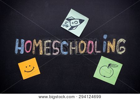 Homeschooling. Word Homeschooling Writing On Blackboard With Paper Notes With A Rocket On It, Apple